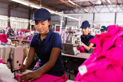 Factory worker sewing Royalty Free Stock Photography