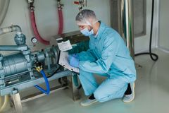 Scientist work with high-pressure tank engine Royalty Free Stock Image