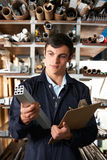 Factory Worker In Store Room With Components. Worker In Store Room With Components Stock Images