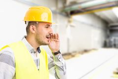 Factory worker or supervisor shouting stock image