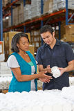 Factory Worker Training Colleague On Production Line. Concentrating Stock Photography