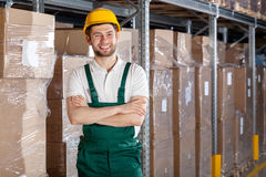 Factory worker in warehouse. With founded hands Stock Photo