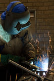 Factory Worker Welding. A Factory Worker Welding on a production line in a factory Stock Photo