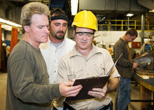 Factory Workers Internal Audit Royalty Free Stock Photos