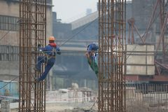 Factory workers at Koksokhim, welders are engaged in the construction and installation of metal structures on high ground. And in special working conditions stock image