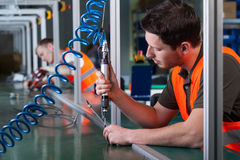 Factory workers and production process Stock Photo