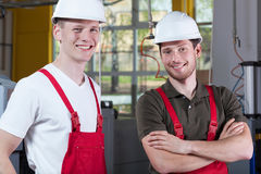 Factory workers taking a break of work Royalty Free Stock Photos