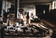 Factory working details with automated lathe drilling and cutting metal Royalty Free Stock Photography
