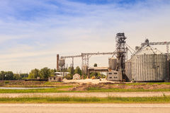 factory yard metal tank of modern silo in countryside Royalty Free Stock Image