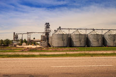 Factory yard metal tank of modern silo in countryside Royalty Free Stock Photos