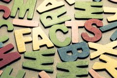 FACTS. Closeup FACTS word in scattered wood letters stock photos