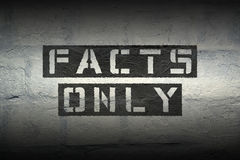 Facts only gr. Facts only stencil print on the grunge white brick wall royalty free stock image