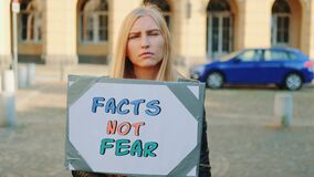 Facts not fear slogan on protest walk