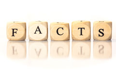 Facts spelled word, dice letters with reflection Stock Images