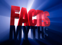 Facts Triumphant. Viewed at a dramatic angle, a bold, red FACTS stands atop a dark gray MYTHS on a dark blue background brilliantly backlit with light rays Royalty Free Stock Photos