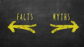 Facts vs Myths. CHoice concept. Facts and Myths text drawn with yellow arrows on chalkboard stock photo