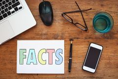 Facts. Word written in notepad Royalty Free Stock Photo