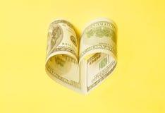 Factures des USA du dollar dans la forme de coeur Photographie stock libre de droits