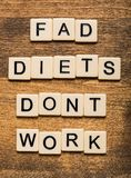Fad. Diet dieting isolated habits popular instructions Royalty Free Stock Photography