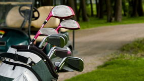 Fade in of golf equipment and golf car stock video footage