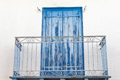 Faded Blue Wooden Doors on White House Royalty Free Stock Images