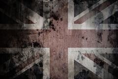 Faded British flag on a cracked cement wall Royalty Free Stock Image