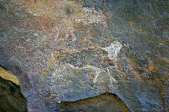 FADED BUSHMAN DRAWING OF AN ANIMAL IN THE EASTERN FREE STATE, SOUTH AFRICA. View of ancient bushman drawings on the interior wall of a rock cave royalty free stock image