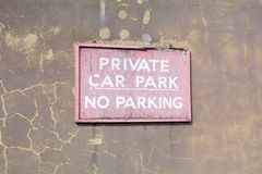 Faded and cracked wooden 'Private Car Park - No Parking' sign Royalty Free Stock Image