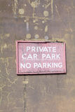 Faded and cracked wooden 'Private Car Park - No Parking' sign Stock Photos