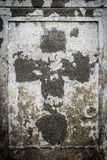 Faded cross  on an old parget wall Stock Photography