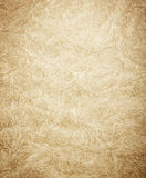 Faded gold textured surface. Abstract background created by faded gold textured grunge surface Stock Photos