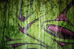 Faded Grafiti on cracked cement wall. For backdrop and composite work Royalty Free Stock Image