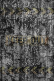 Faded hazard sign on cracked cement wall. For backdrop and composite work Royalty Free Stock Photos