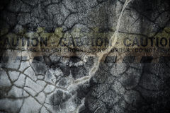Faded hazard sign on cracked cement wall. For backdrop and composite work Royalty Free Stock Photo