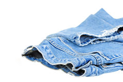 Faded Jeans. Pair of faded denim jeans on a white background stock images