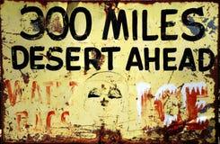 Warning sign `300 miles desert ahead` stock photos