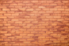 Faded orange brick wall Stock Images