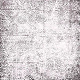 Faded paisley ornaments texture. Paisley ornaments on a faded texture Stock Images