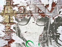 Faded poster on a brick wall. Faded, worn away poster on a red brick wall in Brooklyn, New York Stock Photos