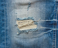 Faded ripped jeans Stock Photo