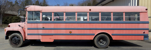 Faded School Bus. Side view of old, worn, faded parked school bus Royalty Free Stock Images