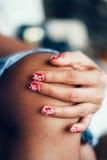 Faded and sensual flowery nail art, retro look. Faded and sensual flowery nail art Stock Photo