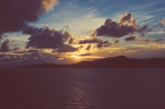 Faded Sunset Over Ocean With Land Royalty Free Stock Photos