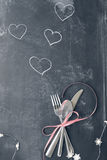 Faded Valentines Day Cutlery over Blackboard Stock Image