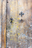 Faded worn old door with key holes Stock Image