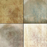 Faded worn wallpaper patterns. Collage of old, dirty, faded wallpaper designs stock photo