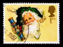Fader Christmas med den traditionella smällaren Jul 1997 - 150. årsdag av smällkaramellserie, circa 1997 Royaltyfria Bilder