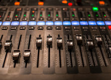 Fader digital mixing console with volume meter Royalty Free Stock Image