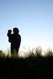 Fader Holding Son Silhouette Royaltyfri Fotografi