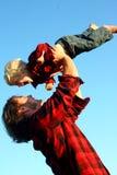 Fader Lifting Son i luft Royaltyfria Foton